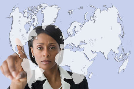 african american woman business: African businesswoman pointing to world map