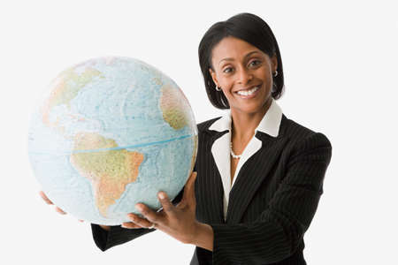 world at your fingertips: African businesswoman holding globe LANG_EVOIMAGES