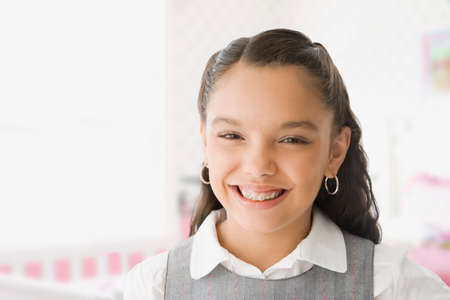 eagerness: Hispanic girl with orthodontic braces LANG_EVOIMAGES