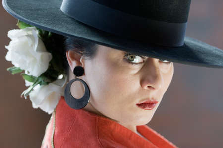relishing: Hispanic woman wearing flamenco outfit