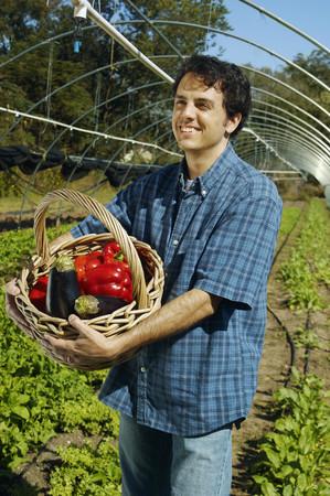 Man holding basket of organic produce