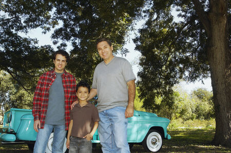citrus family: Multi-ethnic family in front of truck