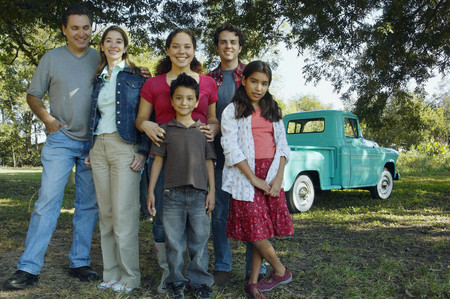 gramma: Multi-ethnic family in front of truck