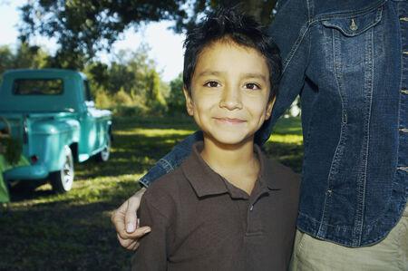 merchant: Hispanic boy with truck in background