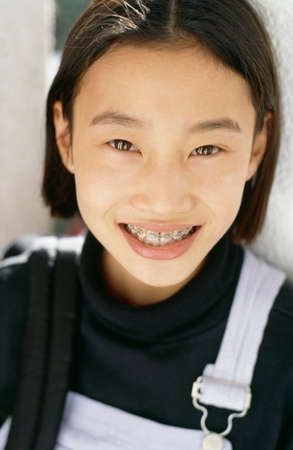 meticulous: Asian girl with orthodontic braces