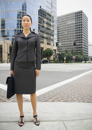 interrogating: Asian businesswoman in urban area