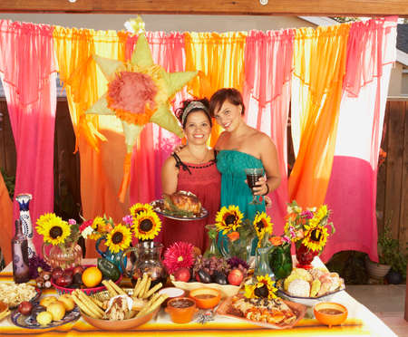 80 plus years: Mother and daughter behind buffet table LANG_EVOIMAGES