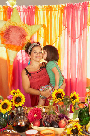 age 40 45 years: Mixed Race mother and daughter behind buffet table LANG_EVOIMAGES