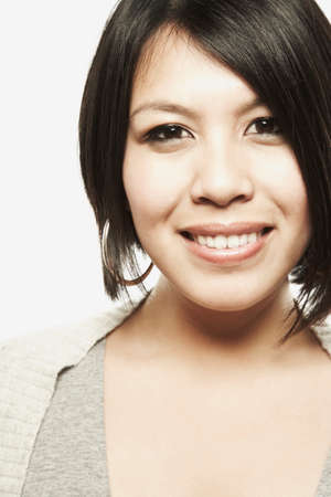 fulfilling: Close up of Asian woman smiling
