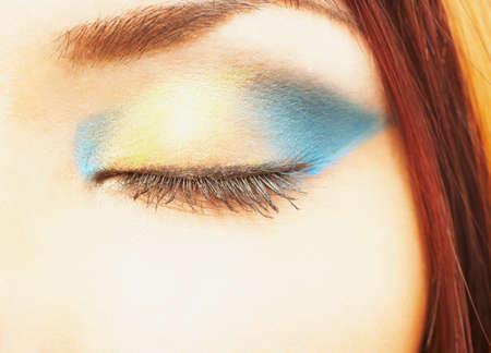 pacific islander ethnicity: Close of eye makeup on Pacific Islander woman