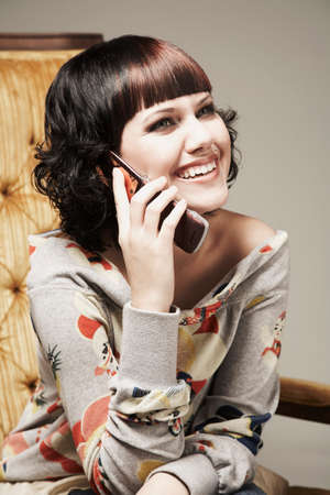 pacific islander ethnicity: Mixed Race woman talking on cell phone LANG_EVOIMAGES