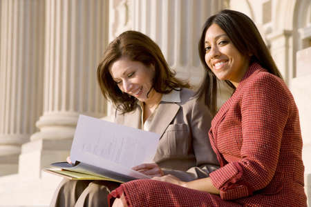 1 woman only: Multi-ethnic businesswomen looking at paperwork