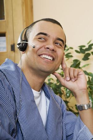 pacific islander: Pacific Islander man wearing headset