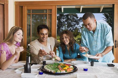 Multi-ethnic couples eating sushi