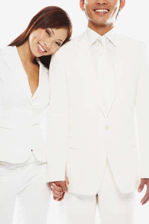 talker: Asian couple holding hands