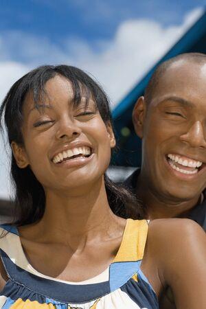 Hispanic couple laughing LANG_EVOIMAGES