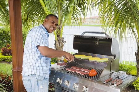 shrieking: African man barbecuing