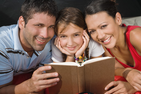 adult entertainment: Hispanic family reading