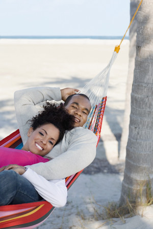 hammock: Hispanic couple laying in hammock LANG_EVOIMAGES