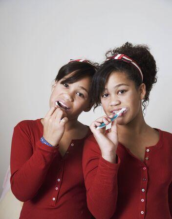 pj's: African twin sisters brushing teeth