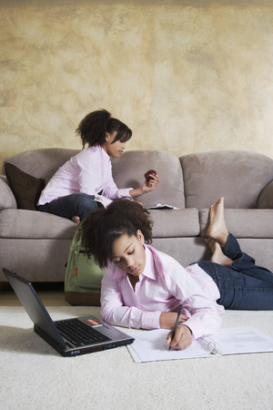 African twin sisters doing homework Stock Photo