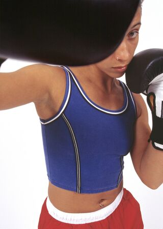 exerting: African woman boxing