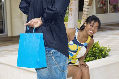 crewcut: Hispanic man surprising girlfriend with gift