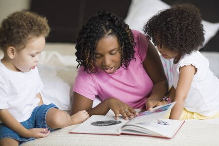 African mother reading to children Stock Photo