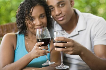 wearying: African couple toasting with wine LANG_EVOIMAGES