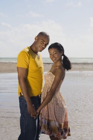 crewcut: Multi-ethnic couple holding hands at beach