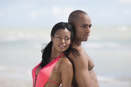 hairless: Multi-ethnic couple standing back to back