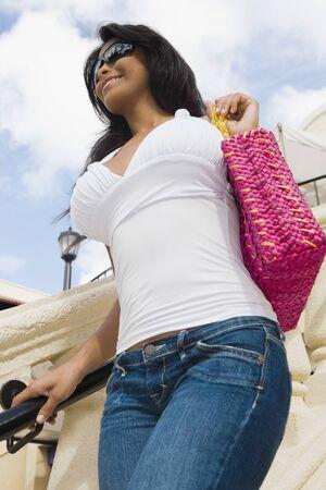 economizing: Hispanic woman holding purse