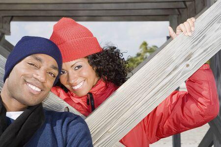 unconcerned: Multi-ethnic couple wearing winter clothing
