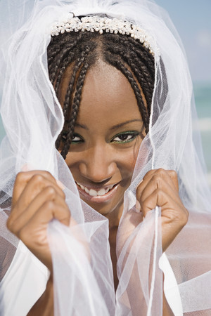 shrieking: African bride pulling veil forward LANG_EVOIMAGES