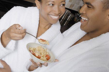 African couple eating breakfast