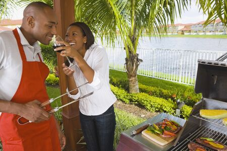 flogging: African couple barbecuing