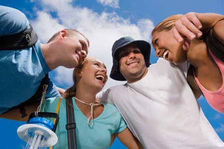 adventuresome: Multi-ethnic friends in huddle