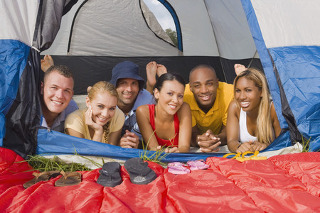 Multi-ethnic friends laying in tent