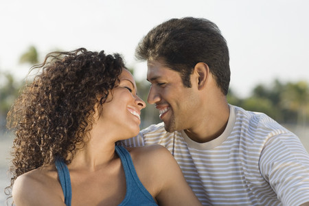 mate married: Hispanic couple smiling at each other