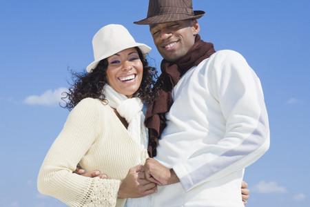 african american couple: Multi-ethnic couple hugging