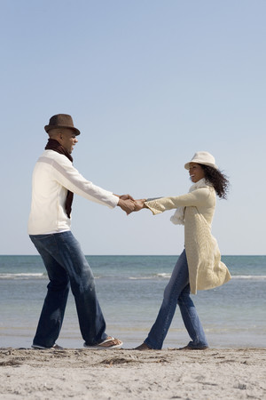 african american couple: Multi-ethnic couple dancing at beach