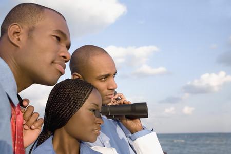 motioning: African businesspeople looking through binoculars