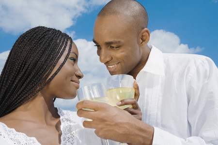 milepost: African couple drinking wine