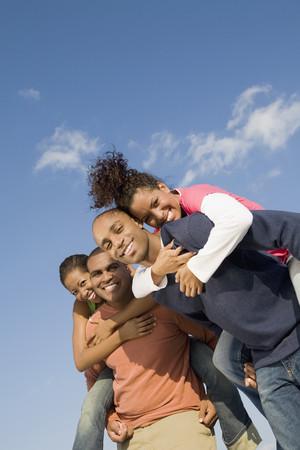 mischievious: African men giving girlfriends piggy back rides