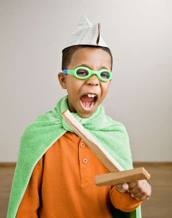 pacific islander ethnicity: Mixed Race boy playing dress-up
