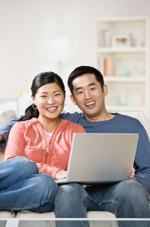 giver: Asian couple holding laptop