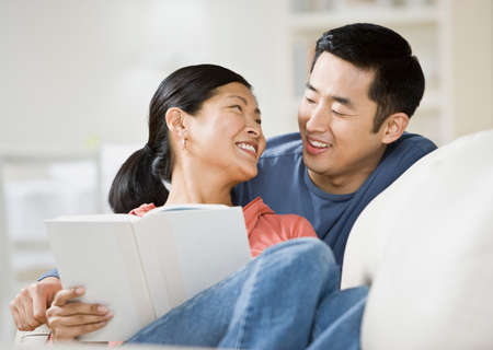 asian adult: Asian couple smiling at each other