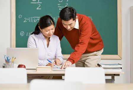 davenport: Asian teachers looking at paperwork