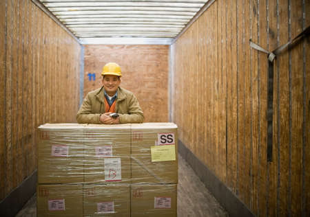 irish ethnicity: Asian warehouse worker with shipment in truck