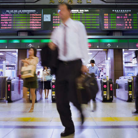 Blurred motion shot of Asian businessman in subway Stock Photo